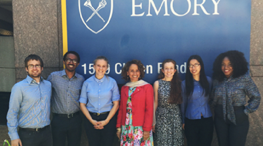 UCL President (center) with Emory Masters In Development Practice students.
